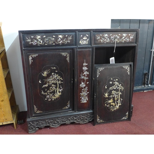 259 - A 19th century Chinese hardwood cabinet, with mother of pearl inlay, raised on carved and pierced ba...