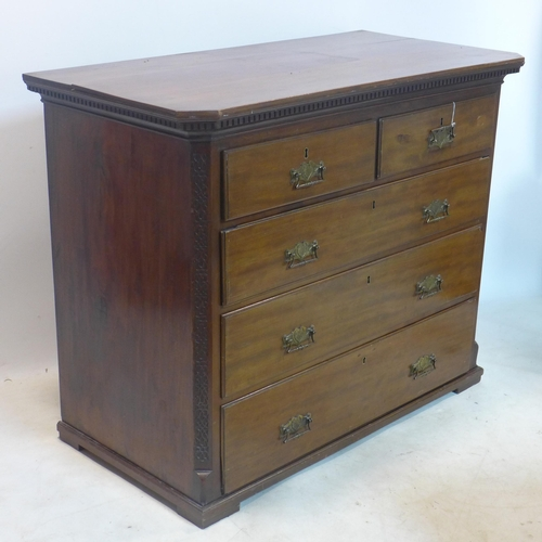 323 - A 19th century mahogany chest of drawers with pierced brass handles having 2 short drawers over 3 lo...
