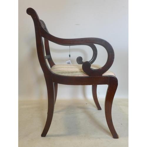 34 - A Regency style brass inlaid mahogany scroll armchair