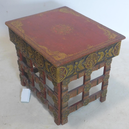 35 - An early 20th century Chinese red lacquered and gilt painted folding table, H.33 W.39 D.33cm...