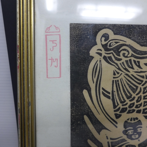 8 - A pair of South East Asian woodblock prints, one depicting a child and elderly man with dragon to ba...