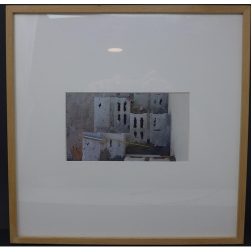 9 - A Greek photographic print of breeze blocks and a folding measuring rule, framed and glazed, 10 x 18...