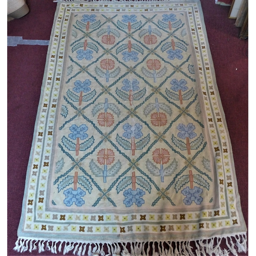 39 - Two Kashmiri embroidered rugs, to include one with central floral medallion and stylised floral moti...
