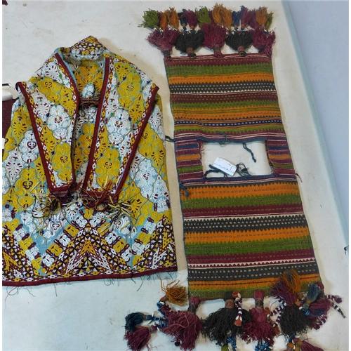 42 - A Turkoman Yomud ceremonial saddle bag, together with a Turkoman silk embroidered kaftan...