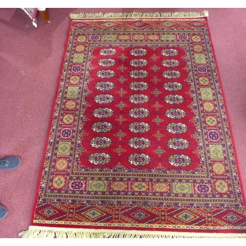 44 - A machine made Bokhara carpet by Bossan, 234 x 164cm...
