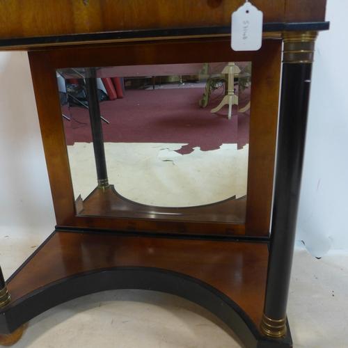 46 - A Biedermeier style part ebonized walnut side table, with single drawer above mirrored back, having ...