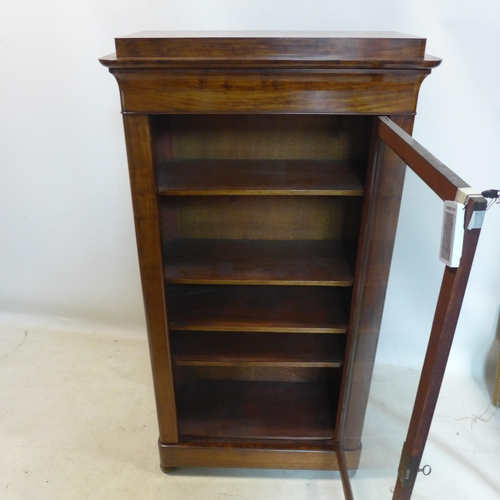 58 - A Victorian mahogany display cabinet, with single drawer above glazed door, enclosing adjustable she...