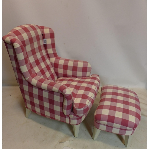 59 - A contemporary wing back armchair and matching foot stool...