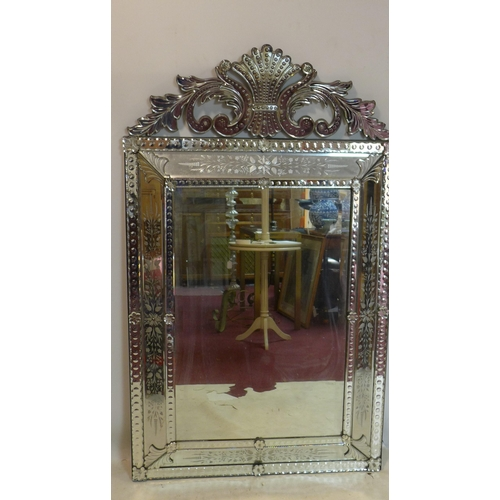 60 - A large 20th century Venetian mirror with acid etched decoration and bevelled plates, 152 x 92cm...