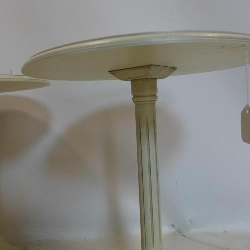 61 - A pair of contemporary cream lamp tables, H.69 D.51cm