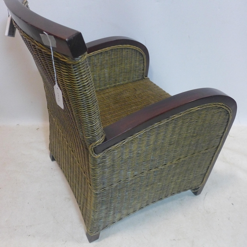 62 - A teak and wicker armchair