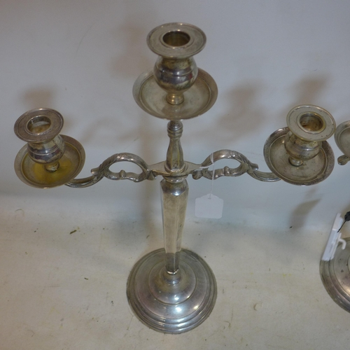 64 - A pair silver plated candelabra, H.56cm...