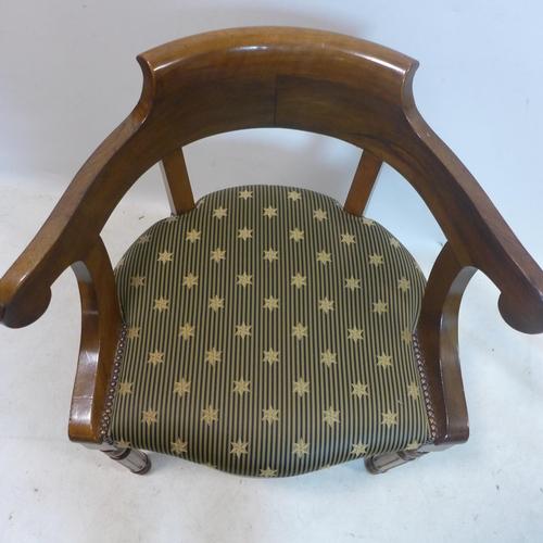 68 - A Regency style teak scroll armchair...