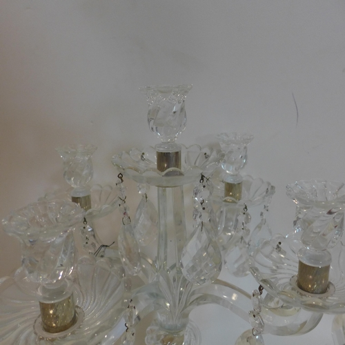 72 - A glass candelabra with glass droplets, H.58cm