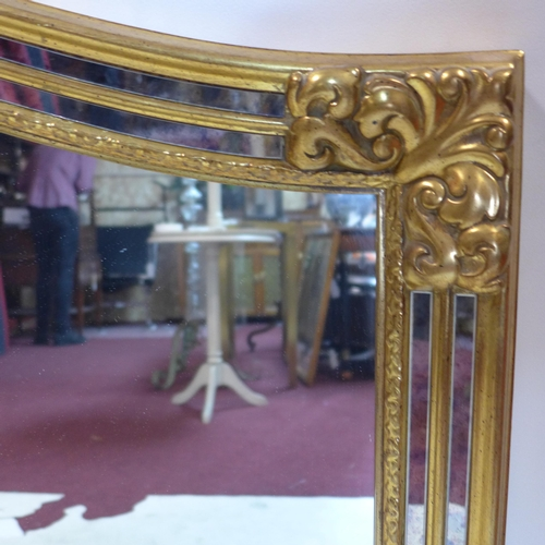 74 - A Venetian style gilt wood mirror, 91 x 129cm...