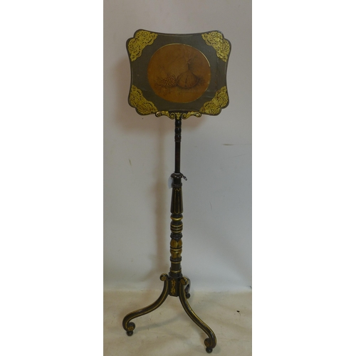 77 - A late 19th/early 20th century ebonised and gilt painted adjustable fire guard, raised on 3 scroll l...