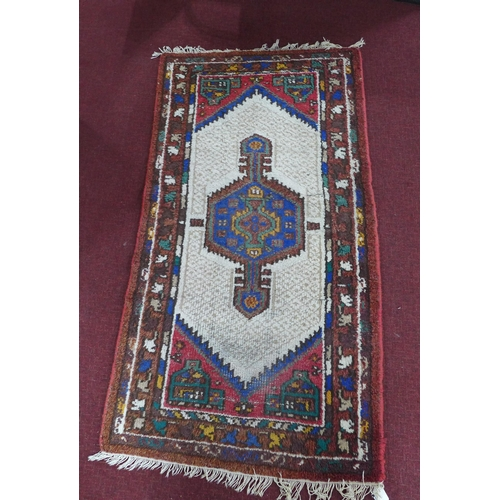 95 - A 20th century Indian rug with geometric design, 193 x 101cm...