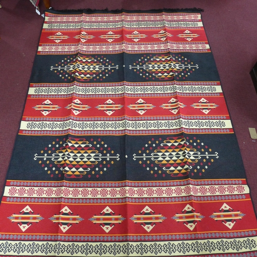 97 - A large modern reversible carpet with multi coloured geometric design, 300 x 197cm...