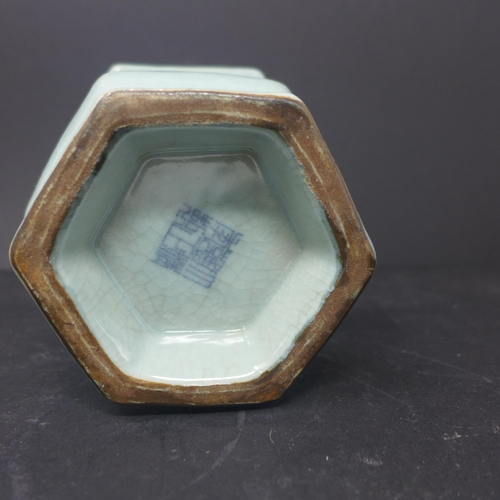 116 - A Chinese celadon glazed vase, of hexagonal form with everted rim, on spreading base, bearing seal m...