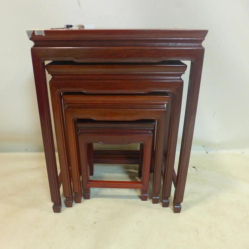 179 - A 20th century Chinese hard wood nest of 4 tables...