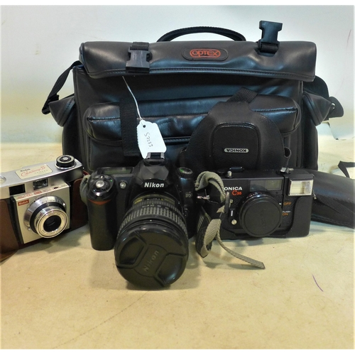 225 - A collection of vintage cameras to include a Nikon, together with a vintage One2One mobile phone...