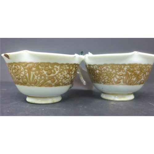 229 - A pair of Japanese white and gilt Imperial style teacups, decorated with a gilt continuous band of s...