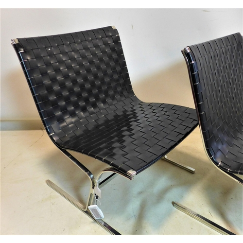 239 - A pair of contemporary chrome and woven vinyl chairs, H.78 W.66 D.69cm...