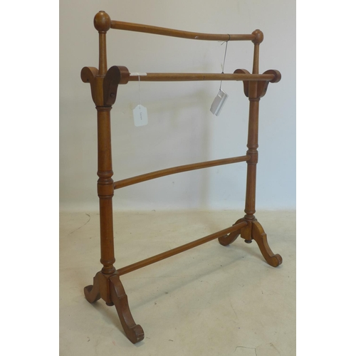 526 - An Edwardian mahogany towel rail...