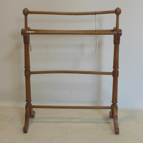 526 - An Edwardian mahogany towel rail...
