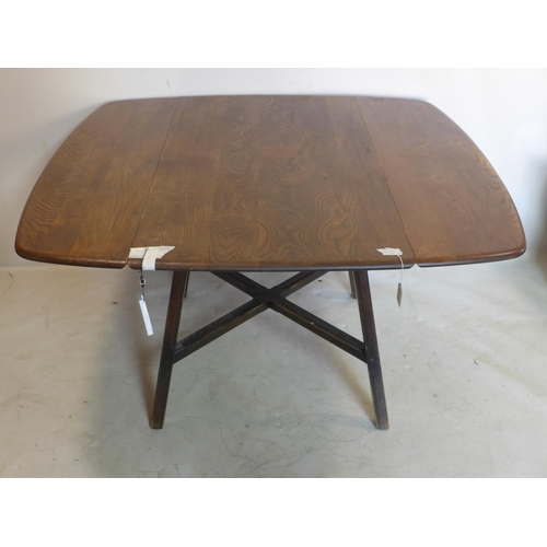 504 - A 20th century Ercol drop leaf dining table...