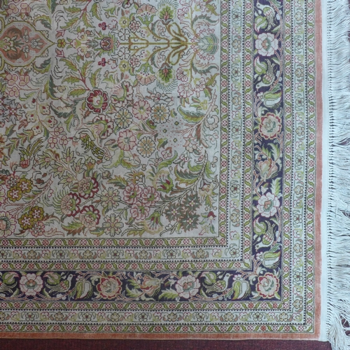 91 - A 20th century fine silk Hereke rug with European design, 156 x 94cm...