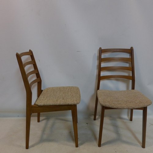 178 - A set of four 20th century teak dining chairs...