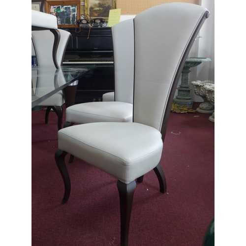 194 - A set of 10 contemporary dining chairs to include 2 carvers, retailed by Aleal of Portugal...