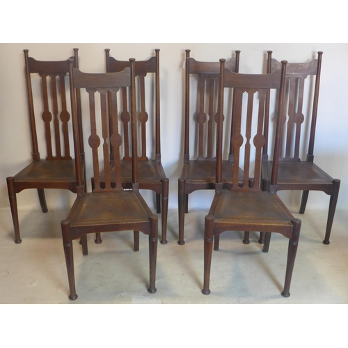 202 - A set of six Arts & Crafts oak dining chairs, possibly Liberty's, with leather covered rush seats...