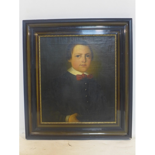 221 - 19th century Continental school, Portrait of a young boy, oil on canvas, in modern black frame, 46 x...