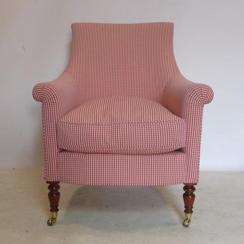 236 - A Regency style armchair with red Gingham upholstery, raised on turned mahogany legs and castors...