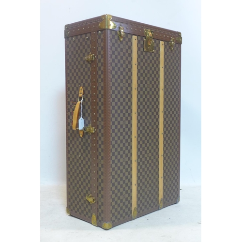 266 - A Louis Vuitton travelling wardrobe, H.92 W.55 D.30cm...
