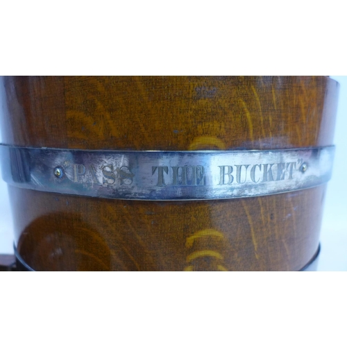 268 - A late 19th/early 20th century oak barrel with Tantalus and pull out shot glasses compartment, havin...