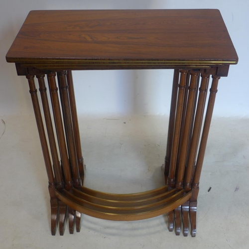 287 - A Regency rosewood nest of 4 tables with brass inlay...