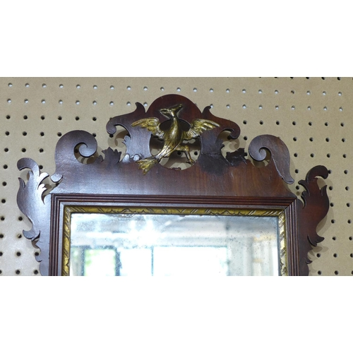 304 - A Georgian fretwork mirror, with pierced scrolling design and gilt phoenix motif, having ghosted pla...