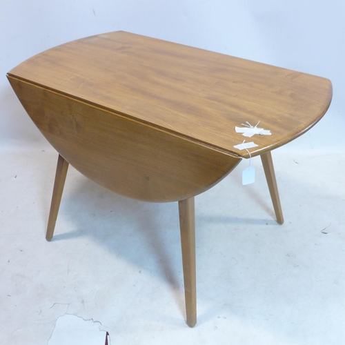 306 - An Ercol elm drop flap dining table, H.72 L.112cm...