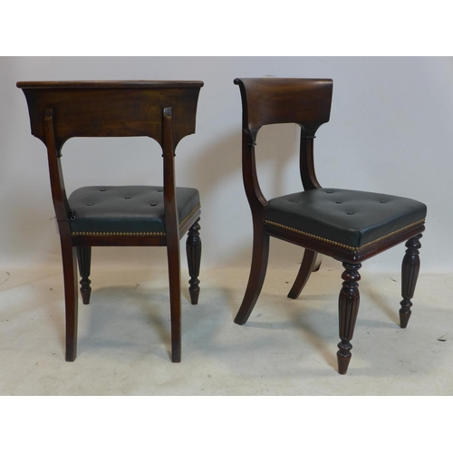 319 - A set of six William IV mahogany dining chairs with green studded leather seats...