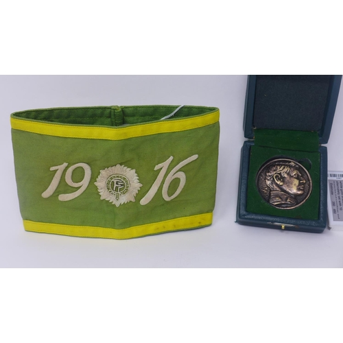 721 - An embroidered 1916 rising armband together with a Michael Collins badge in box...