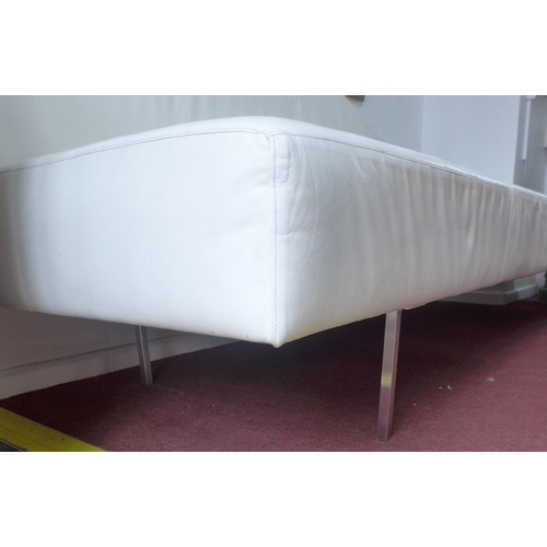 515 - A contemporary white leather chaise longue, L.240cm...