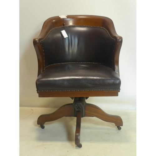 501 - A late 19th/early 20th century Globe Wernicke mahogany captains swivel desk chair...