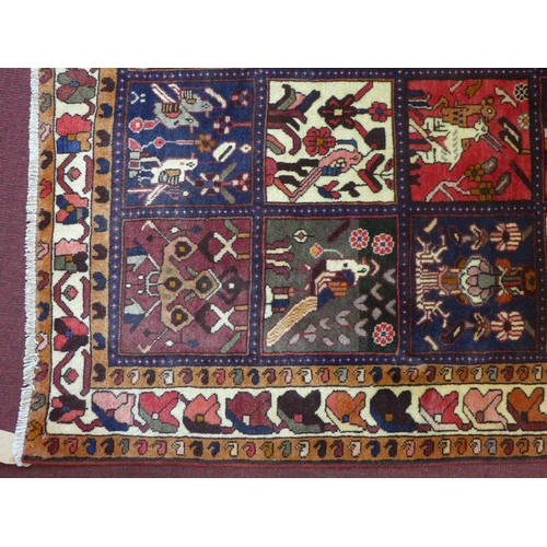 504 - A Central Persian Bakhtiari rug, panels of animal and petal motifs repeating accross the field, with...