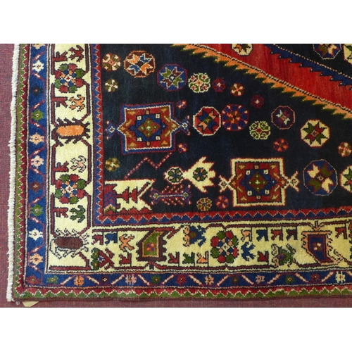 507 - A North-West Persian Zanjan rug, central double pendent medallion with repeating petal motifs on a m...