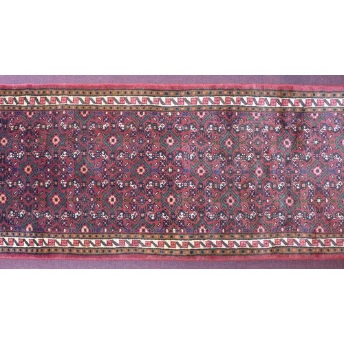 509 - A North-West Persian Malayer runner, repeating stylised diamond motifs with petal motifs on a terrac...