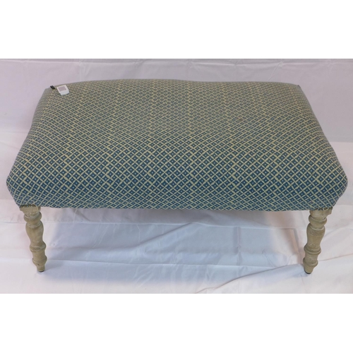 524 - A large contemporary ottoman/hearth stool, raised on turned legs, H.47 W.104 D.69cm...