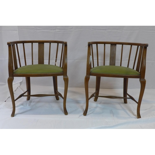 525 - A pair of Edwardian mahogany tub chairs with velour seats...